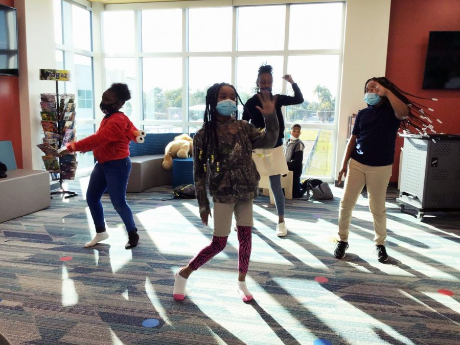 Culutural Expressions members Ozi'yana Morton, Za-riyah Herring, Jamia Sutton and Zachyliah Herring practice a dance routine in the media center.