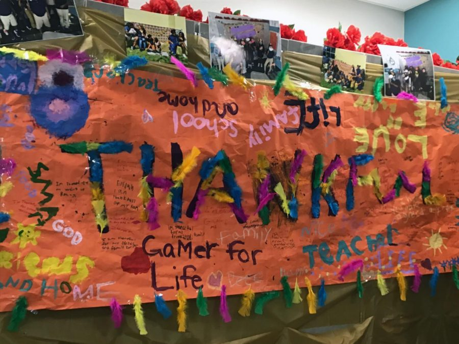 A Thanksgiving banner created by fourth grade scholars portraying things they are thankful for.