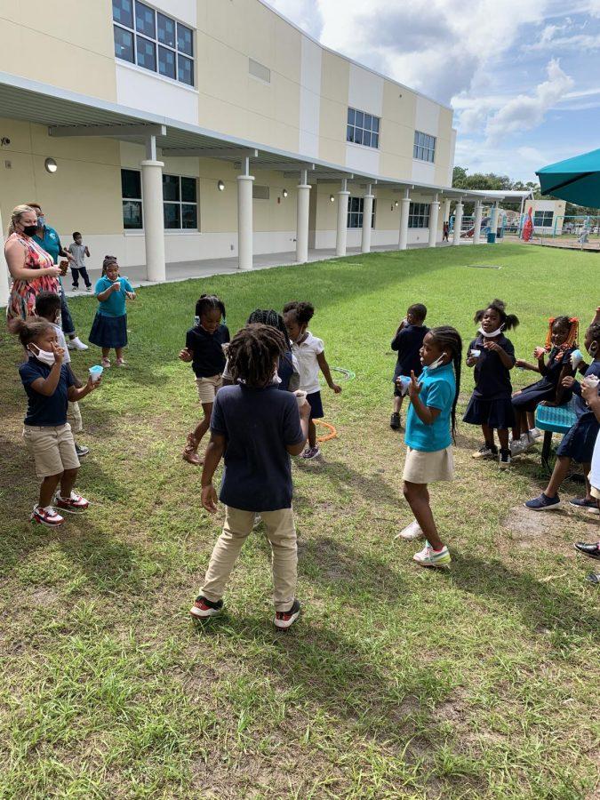 Kindergarten scholars enjoy snowcones during Fun Friday.