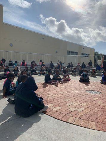 Kindergarten scholars prepare to perform for the winter concert.
