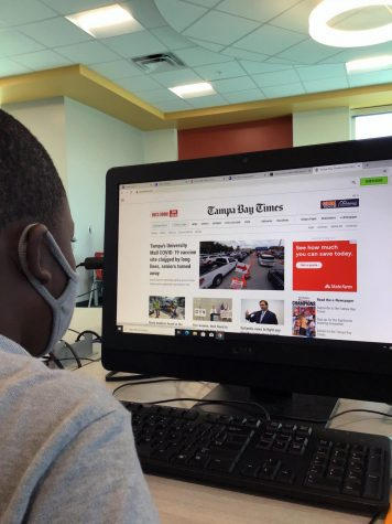 Fourth grade scholar Travis Flowers accesses the Tampa Bay Times online to conduct research for a story.