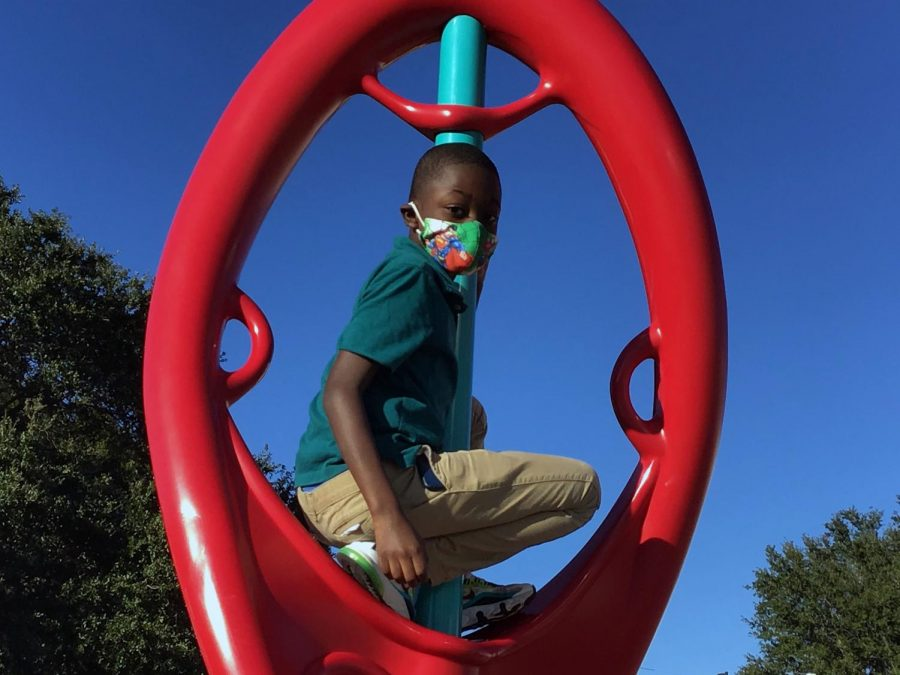 Fourth grader, Travis Flowers, sits atop the playground.