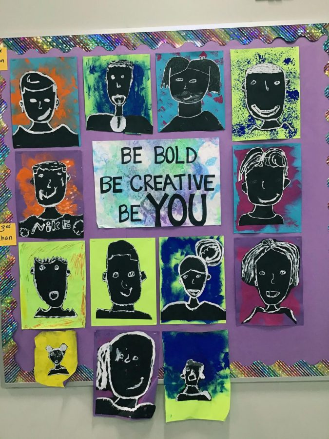 A collection of self portraits hang in the art room encouraging scholars to be themselves.